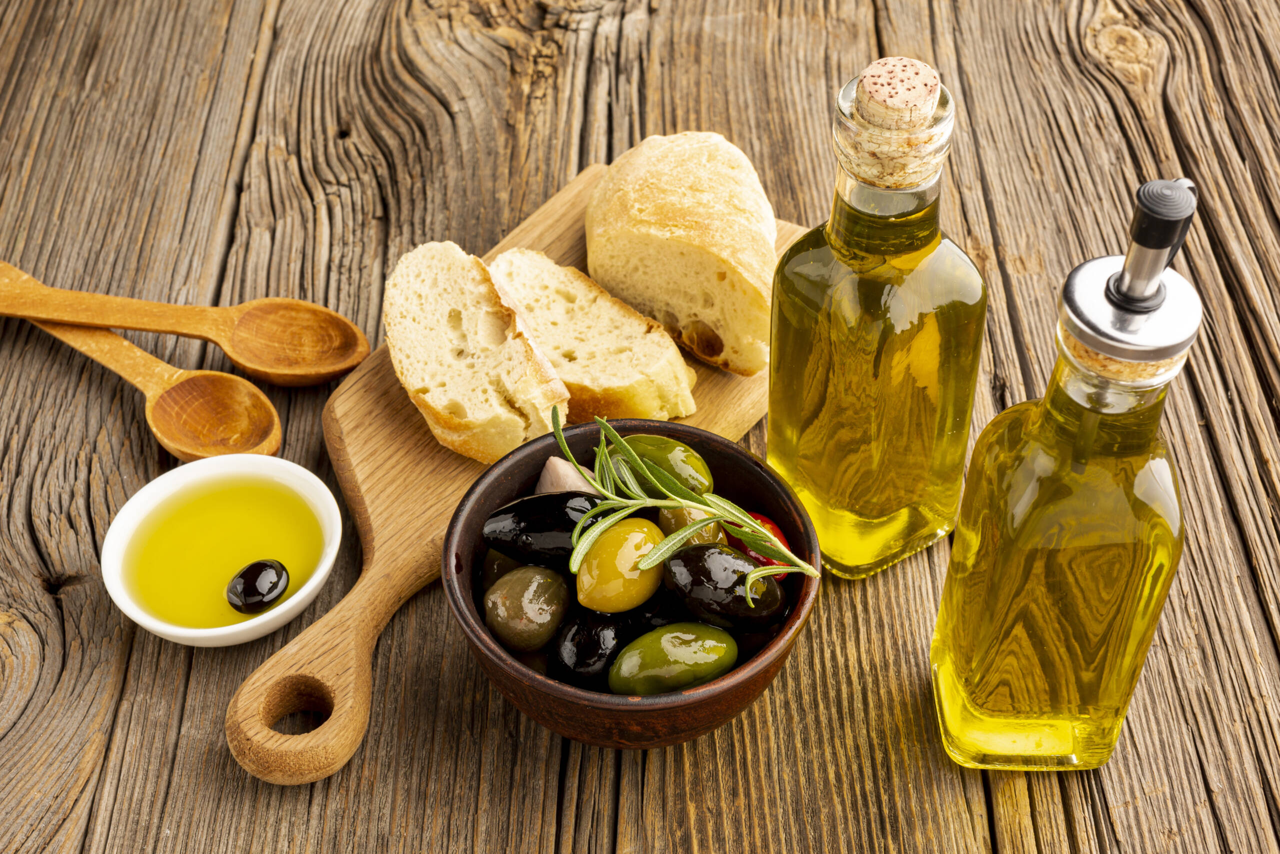 high-angle-olives-mix-bread-oil-bottles-scaled